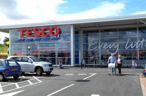 Tesco slashes £400m from revamp